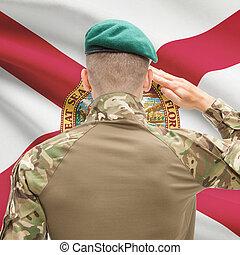 Soldier saluting to USA state flag conceptual series - Florida
