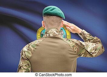 Soldier saluting to USA state flag conceptual series - Idaho...