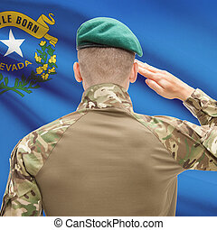 Soldier saluting to US state flag series - Nevada