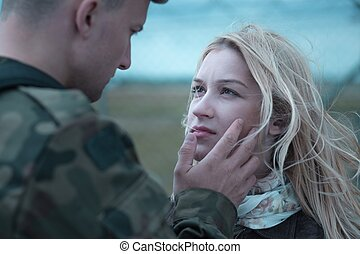 Soldier saying goodbye to beauty upset wife