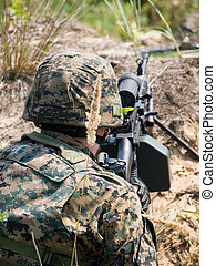 Soldier shooting his machine gun - The Canadian Army soldier...