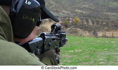 Soldier shooting with automatic gun - Military shooting from...