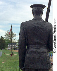 soldier statue stands guard