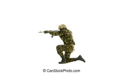 Soldier took aim, while standing on one knee. White...