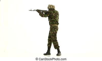 Soldier took aim. White backgraund - Soldier took aim, a man...