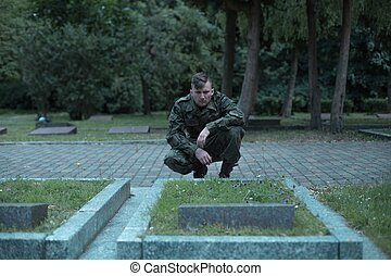 Soldier visiting cemetery