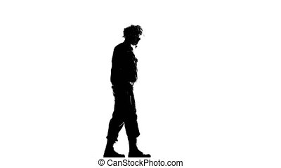 Soldier walking with a gun in his hand. Silhouette - Soldier...