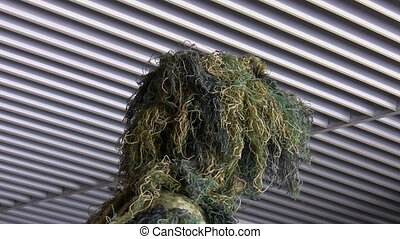 Soldier wearing ghillie suit - Head and shoulders of a...