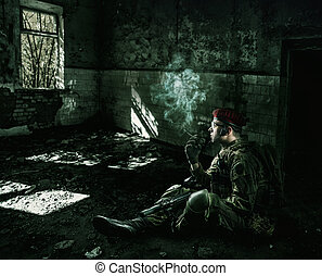 soldier wearing military uniform in the destroyed building