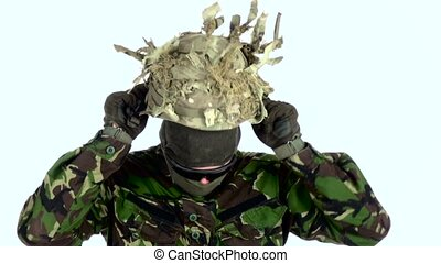 Soldier wears a helmet on his head. White backgraund -...