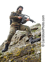 Soldier with a gun moving