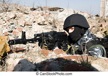 Soldier with AK-47 rifle targeting
