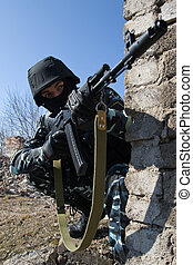 Soldier with automatic rifle in covered postion - Officer ...