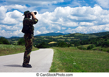 soldier with binoculars
