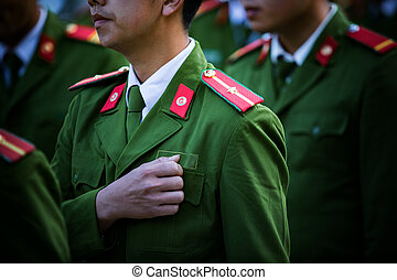 soldier with green uniform marching in row