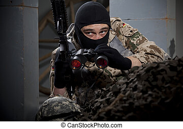 Soldier with gun and binoculars