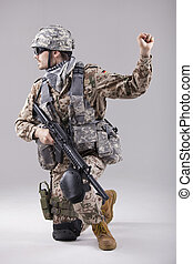 soldier with hand warning gesure