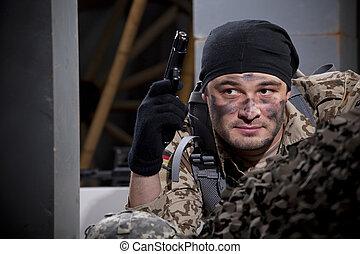 Soldier with handgun hiding