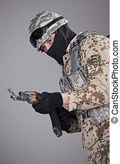 Soldier with kalashnikov machine gun - Soldier in camouflage...