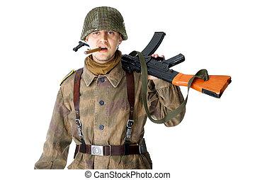 Soldier with machine gun smoking a cigar