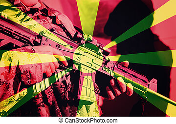 Soldier with machine gun with national flag of Macedonia