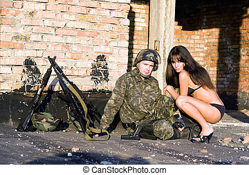 Soldier with sexy woman