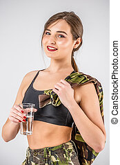 Soldier woman drinking water after exercise