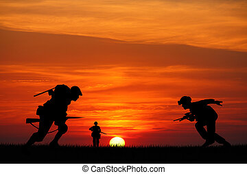 soldiers at war - soldiers silhouette at sunset