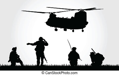 Soldiers. - A group of soldiers guiding a helicopter to...