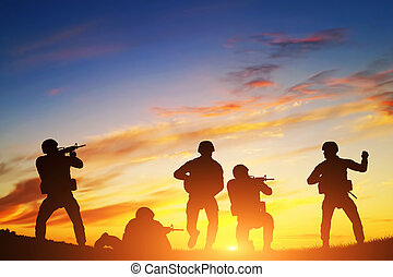 Soldiers in assault. War, army, military.