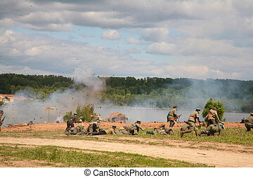 Soldiers in attack in military show from first world war -...