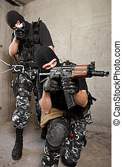 Soldiers in black masks with weapons
