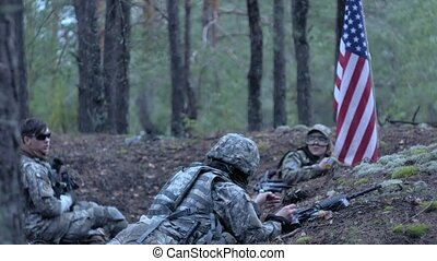 Soldiers in camouflage with combat weapons and in the US in...