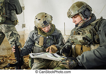 soldiers in the room looking at the map - rangers in the...