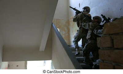 Soldiers on a mission to kill terrorist leader ascending to...