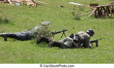 Soldiers on the battlefield - Soldiers shooting on the...