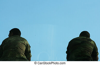 Soldiers - two Soldiers in uniform waiting for deployment