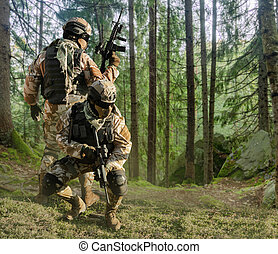 Soldiers posing in forest.