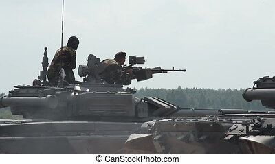 soldiers shoots from tank-mounted machine guns - the firing...