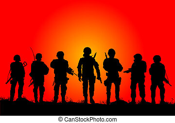 Soldiers silhouettes on a filed in the sunset