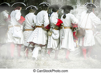 Soldiers with musket and jacket during the re-enactment of...