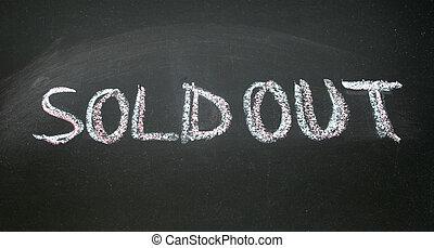 soldout written with chalk on blackboard