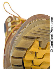 Sole of shoe     - Close up of the sole of a winter shoe