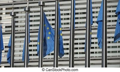 Solemn EU flags fluttering at the European Commission in...