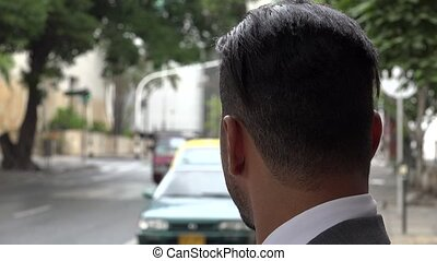 Solemn Man Waiting with Traffic