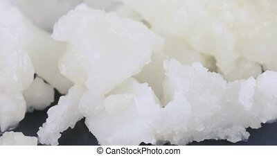 Solid coconut oil in bulk - Slices of solid coconut oil on a...