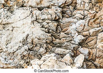 Solid limestone rock texture with muliple cracks