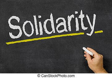 Solidarity written on a blackboard