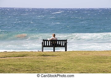 Solitary Female Sitting on Wooden Bench