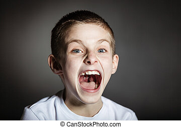 Solitary frightened boy screams in terror - Solitary ...
